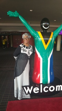 Thamendrie at the entrance of ICC 2018 Indaba